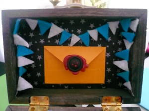 inside box with mini letter and banner